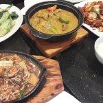 Fried bak choy, curry beef, chili pork and fried tofu