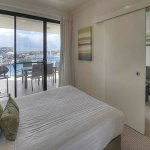 Queen bed, balcony access from room+lounge View of Marina.