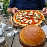 Pizza and the winning bread baked in a clay pot.