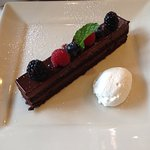 Chocolate Mousse Cake: Berries, whipped cream, salted caramel sauce