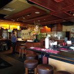 As you arrive the bar ares is to your right. Great area to dine if you like to gab while you eat