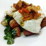 Haddock grenobloise with roasted seasonal veggies and house-made croutons & tomato sauce.