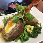 Haggis Scotch Egg with Ale Chutney, buttered Green Vegetables, and Crispy Bacon Tuille