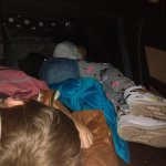 my view of my kids sleeping in the car