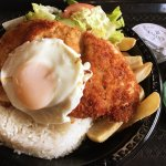 Milanesa de Pollo (pan fried breaded chicken, fried egg) w/white rice, fries, and salad