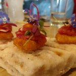 Amuse-bouche of fried cheese and alpaca