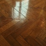 the beautiful polished herringbone floor