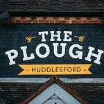 Our logo above the front entrance to The Plough.
