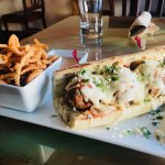 Meatball sub special served with our buttermilk battered onion strings