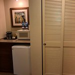 Microwave, refrigerator, coffee maker in room