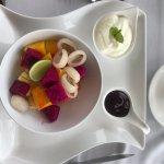 breakfast fruit, yogurt and raspberry coulis