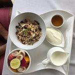 breakfast muesli, fruit and yogurt