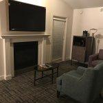 Little gas fireplace below the TV
