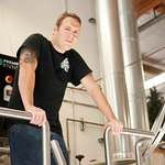 Bob working on the Brewing deck between mashtun and kettle