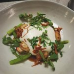 Seared Koh Kong scallops with garlic and tofu cream, asparagus, purslane and aged salted lime ja