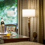Sip on endless flutes of champagne while you gaze at the lush gardens from our Taj Club Rooms