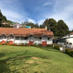 Rooms at the hotel overlooking the garden and the city of Ooty.