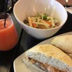 Salmon tinaktak sandwich, strawberry mimosa, and marinated tofu rice bowl.
