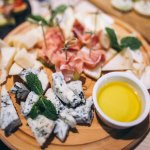 Cheese plate with parma rolls
