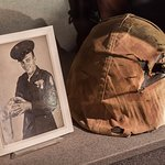 A Marine's helmet that took a sniper round. The Marine can be seen holding the helmet.
