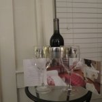Gift Bottle of wine from Veritas Winery and glasses in the room