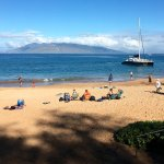 Makena Beach that you walk down to & get into catamaran from water.