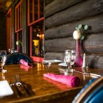 Our dining room features rustic charm and spectacular views.