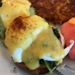 Traditional Benedict with hash brown and seasonal fruits