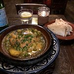 Essaouira Tajine - tender chicken breast , moroccan olives , and potato , simmered in a saffron