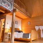 Timber-frame chalets at our Tweedsmuir Park Lodge location