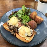 Eggs Benedict on mixed mushrooms