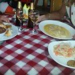 Nuestra cena. plato montañero y pescado al ajillo