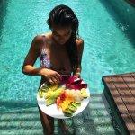 Enjoying a fruit platter in the pool of my villa.