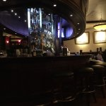 The lively bar is front and center in the restaurant