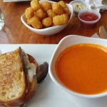 Grilled cheese with a very tasty tomato-y soup and tater tots