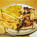 1/2 chicken plate with Portuguese rice and PERi chips