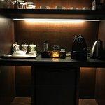In room mini bar and coffee/tea service.