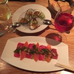 Kusshi oysters and a sashimi plate of Ahi and Salmon