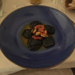 Squid ink ravioli with shrimps and mussels