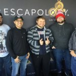 Poker players doing an escape room.