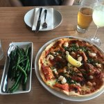Seafood pizza and green beans infused with anchovy and chili. Delicious!