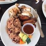 Jerk Chicken, black beans and rice, fried plantains