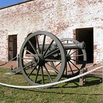 A solitary field cannon stands just inside Fort Macon's sally port.
