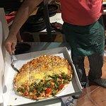 Mangiato di une vera pizza italiani da un vero maestro della pizza buona compagnia e simpatia e