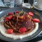 Ricotta pancakes with strawberries, syrup and honeycomb