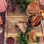 Burgers (one without the bun) with bacon, cheese, salad, bloody Mary dressing and wonderful chip