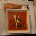 There delicious homemade tomato soup with warm bread