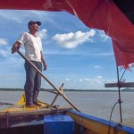 our boat captain, looking for river dolphins (he found them!)