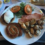 Vanessa's breakfast with cumberland sausage, pea-shoots