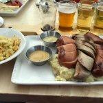 Bratwurst, Knockwurst, Bauernwurst over mashed potatoes with sauerkraut and a side of Spaetzle.